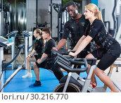 Купить «Athletic young people during functional workout with electric muscle stimulation in fitness gym», фото № 30216770, снято 16 апреля 2018 г. (c) Яков Филимонов / Фотобанк Лори
