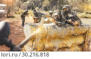 Купить «Paintball players aiming and shooting with guns», фото № 30216818, снято 22 сентября 2018 г. (c) Яков Филимонов / Фотобанк Лори