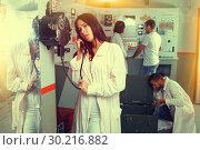 Купить «Girl using telephone set in escape room», фото № 30216882, снято 8 октября 2018 г. (c) Яков Филимонов / Фотобанк Лори