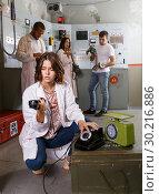 Купить «Girl talking on old telephone in quest room», фото № 30216886, снято 8 октября 2018 г. (c) Яков Филимонов / Фотобанк Лори