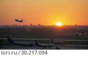 Купить «Airport view at golden sunset with an airplane taking off», видеоролик № 30217094, снято 19 марта 2019 г. (c) Данил Руденко / Фотобанк Лори