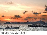 Купить «Boats sails through the South China Sea. The nest. Palawan. Palawan s El Nido stunning scenery made of limestone hills and lagoons El Nido The Philippines.», фото № 30221678, снято 14 января 2019 г. (c) age Fotostock / Фотобанк Лори