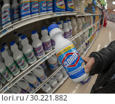 Купить «A shopper chooses a bottle of Clorox bleach in a supermarket in New York on Tuesday, October 30, 2018.», фото № 30221882, снято 30 октября 2018 г. (c) age Fotostock / Фотобанк Лори