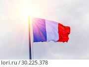 Купить «The national flag of France flutters in the wind against the blue cloudy sky.», фото № 30225378, снято 21 июня 2018 г. (c) Акиньшин Владимир / Фотобанк Лори
