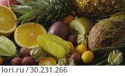 Купить «Watering of fresh natural organic fruits with palm leaves. Exotic fruity vegan background . Motion, 4K UHD video, 3840, 2160p.», видеоролик № 30231266, снято 4 июля 2018 г. (c) Ярослав Данильченко / Фотобанк Лори