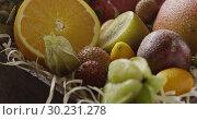 Купить «Pouring water on a fresh organic natural exotic fruits. Close-up video. Panoramic motion, 4K UHD video, 3840, 2160p.», видеоролик № 30231278, снято 4 июля 2018 г. (c) Ярослав Данильченко / Фотобанк Лори