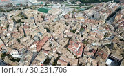 Купить «Urban view from drone of roofs of residential buildings in Spanish city of Huesca», видеоролик № 30231706, снято 24 декабря 2018 г. (c) Яков Филимонов / Фотобанк Лори