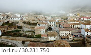 Купить «View from drone of roofs of houses in traditional village of Liedena in foggy morning, Navarre, Spain», видеоролик № 30231750, снято 23 декабря 2018 г. (c) Яков Филимонов / Фотобанк Лори