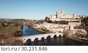 Купить «Aerial view of Beziers with Old Bridge and Cathedral of Saint Nazaire, France», видеоролик № 30231846, снято 6 января 2019 г. (c) Яков Филимонов / Фотобанк Лори
