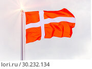 Купить «The national flag of Denmark flutters in the wind against the blue cloudy sky.», фото № 30232134, снято 21 июня 2018 г. (c) Акиньшин Владимир / Фотобанк Лори