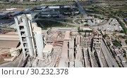 Купить «Industrial background with large cement factory. Aerial view», видеоролик № 30232378, снято 29 июля 2018 г. (c) Яков Филимонов / Фотобанк Лори