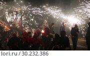Купить «Popular street entertainment Correfoc during celebration of traditional annual festival of La Merce», видеоролик № 30232386, снято 22 сентября 2018 г. (c) Яков Филимонов / Фотобанк Лори