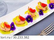 Купить «Ceviche of marinated salmon with kiwi, kumquat, figs», фото № 30233382, снято 21 ноября 2019 г. (c) Яков Филимонов / Фотобанк Лори