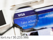 Купить «New York, USA - 4 March 2019: Visa Inc. official website homepage under magnifying glass. Concept Visa Inc., Payment systems logo visible on smartphone, tablet screen,», фото № 30233986, снято 24 февраля 2019 г. (c) Сергей Тимофеев / Фотобанк Лори