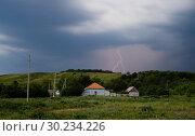 Купить «A real summer thunderstorm in the countryside», фото № 30234226, снято 10 июня 2012 г. (c) Александр Клёнов / Фотобанк Лори