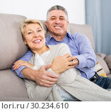 Купить «glad mature married couple in house are warmly reconciled after quarrel», фото № 30234610, снято 27 июня 2019 г. (c) Яков Филимонов / Фотобанк Лори