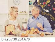 Купить «Mature couple having breakfast at festive Christmas table», фото № 30234670, снято 19 марта 2019 г. (c) Яков Филимонов / Фотобанк Лори