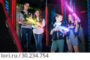 Boy and girl in beams on lasertag arena. Стоковое фото, фотограф Яков Филимонов / Фотобанк Лори