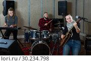 Купить «excited girl rock singer with guitar during rehearsal», фото № 30234798, снято 26 октября 2018 г. (c) Яков Филимонов / Фотобанк Лори