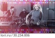 Купить «excited girl rock singer with guitar during rehearsal», фото № 30234806, снято 26 октября 2018 г. (c) Яков Филимонов / Фотобанк Лори