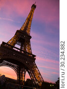 Купить «Eiffel Tower on sunset sky background», фото № 30234882, снято 9 октября 2018 г. (c) Яков Филимонов / Фотобанк Лори