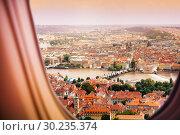 Купить «Prague Czechia town view from plane window», фото № 30235374, снято 21 августа 2015 г. (c) Сергей Новиков / Фотобанк Лори