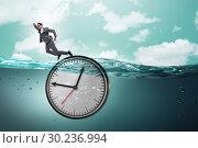Купить «Businessman in deadline and time management concept», фото № 30236994, снято 19 марта 2019 г. (c) Elnur / Фотобанк Лори