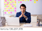 Купить «Young handsome employee in front of whiteboard with to-do list», фото № 30237378, снято 16 октября 2018 г. (c) Elnur / Фотобанк Лори