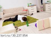 Купить «Young man having hangover after party», фото № 30237954, снято 6 октября 2018 г. (c) Elnur / Фотобанк Лори