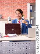 Купить «Young handsome employee working in the office», фото № 30238074, снято 12 сентября 2018 г. (c) Elnur / Фотобанк Лори