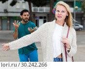 Купить «Couple is quarrelling because of the disagreements between them», фото № 30242266, снято 10 августа 2017 г. (c) Яков Филимонов / Фотобанк Лори