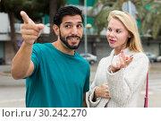 Купить «Man is asking woman stranger about road to hotel», фото № 30242270, снято 10 августа 2017 г. (c) Яков Филимонов / Фотобанк Лори