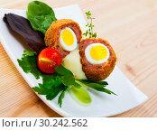 Купить «Dish of English cuisine - Scotch egg», фото № 30242562, снято 20 марта 2019 г. (c) Яков Филимонов / Фотобанк Лори