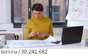 Купить «architect with blueprint and laptop at office», видеоролик № 30242682, снято 28 февраля 2019 г. (c) Syda Productions / Фотобанк Лори
