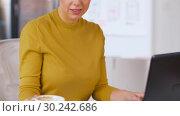 Купить «businesswoman with laptop working at office», видеоролик № 30242686, снято 28 февраля 2019 г. (c) Syda Productions / Фотобанк Лори