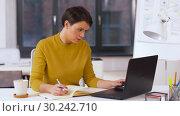 Купить «businesswoman writing to notebook at office», видеоролик № 30242710, снято 28 февраля 2019 г. (c) Syda Productions / Фотобанк Лори