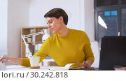 Купить «businesswoman writing to notebook at office», видеоролик № 30242818, снято 28 февраля 2019 г. (c) Syda Productions / Фотобанк Лори