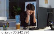 Купить «tired businesswoman working at night office», видеоролик № 30242890, снято 28 февраля 2019 г. (c) Syda Productions / Фотобанк Лори