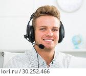 Купить «Portrait of male employee with headset», фото № 30252466, снято 14 декабря 2019 г. (c) Яков Филимонов / Фотобанк Лори