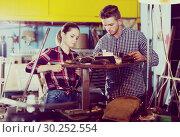 Купить «masters working together near table», фото № 30252554, снято 10 октября 2017 г. (c) Яков Филимонов / Фотобанк Лори