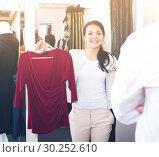 Купить «Glad young couple purchasing dress and blouse», фото № 30252610, снято 24 октября 2016 г. (c) Яков Филимонов / Фотобанк Лори