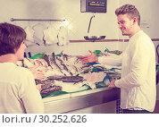 Купить «Cheerful customers choosing seafood in store», фото № 30252626, снято 25 октября 2016 г. (c) Яков Филимонов / Фотобанк Лори