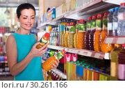 Купить «Female is holding bottle with juice», фото № 30261166, снято 6 июня 2017 г. (c) Яков Филимонов / Фотобанк Лори
