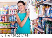 Купить «Woman choosing detergent for washing», фото № 30261174, снято 6 июня 2017 г. (c) Яков Филимонов / Фотобанк Лори