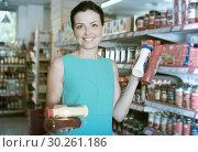 Купить «Woman choosing different sauces», фото № 30261186, снято 6 июня 2017 г. (c) Яков Филимонов / Фотобанк Лори