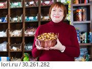 Купить «woman buyer choosing chocolate candies», фото № 30261282, снято 15 декабря 2017 г. (c) Яков Филимонов / Фотобанк Лори