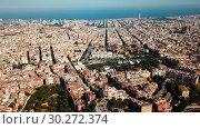 Купить «Modern cityscape of Barcelona on background with water surface of Mediterranean», видеоролик № 30272374, снято 25 июля 2018 г. (c) Яков Филимонов / Фотобанк Лори