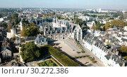 Купить «View from drone of impressive Royal Chateau de Blois on background with cityscape in sunny autumn day, France», видеоролик № 30272386, снято 25 октября 2018 г. (c) Яков Филимонов / Фотобанк Лори