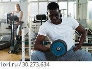 Купить «Man doing strength exercises with barbell», фото № 30273634, снято 25 февраля 2019 г. (c) Яков Филимонов / Фотобанк Лори