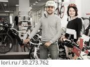 Smiling couple in helmet standing near bicycle. Стоковое фото, фотограф Яков Филимонов / Фотобанк Лори